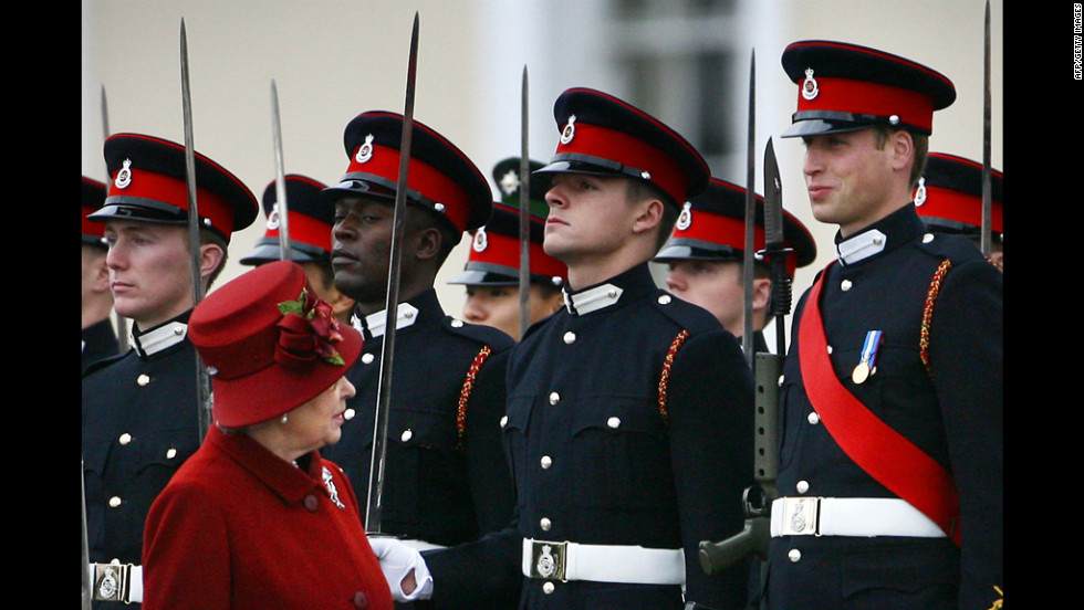 Queen Elizabeth glances up at her grandson, right, as she inspects the parade at the Royal Military Academy in 2006. Prince William graduated as an Army officer and later went on to receive his Royal Air Force pilot's wings