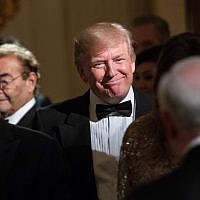 US President Donald Trump makes his way to his seat at the White House Historical Association dinner at the White House in Washington, DC, on September 14, 2017. (AFP PHOTO / NICHOLAS KAMM)