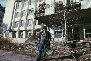 Phil & the not quite AEC building of Pripyat (photo by Robyn von Swank, 2016)