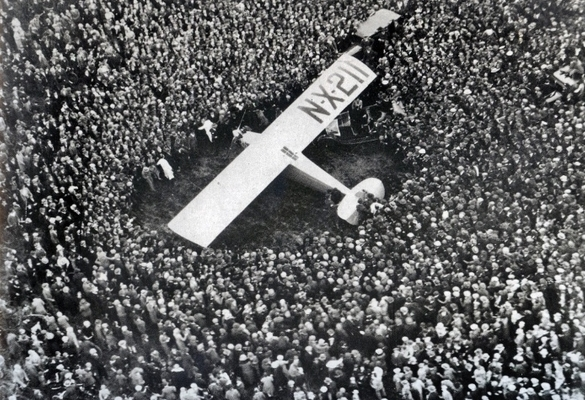 Lindbergh lands outside Paris, and Fox Movietone records the crowd for its coverage.