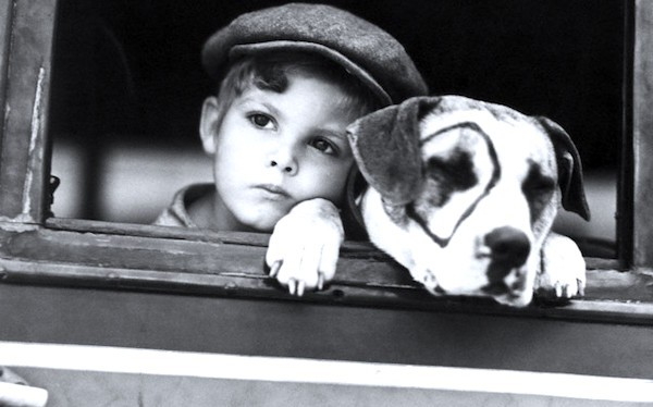 As a Little Rascal, with Pete, who turned out to be played by Pete and all of his five kids (their eye circles weren't all on the same side, which flew at Hal Roach but never would have passed muster at MGM)