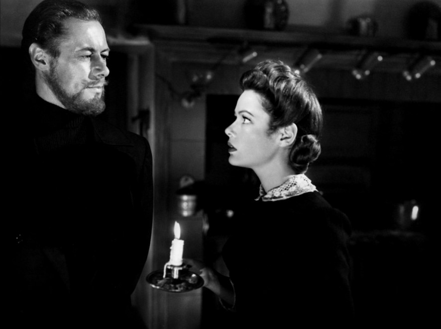 Ghost meets girl: Their first scene together and the only it-was-a-dark-and-stormy-night scene. The dark kitchen and both of them in black establishes that their romance will be disembodied, a relationship of spirits.