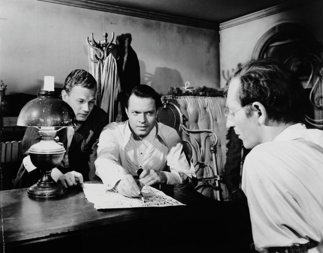 Cotten, Welles, and Sloane putting together their first edition of The Inquirer