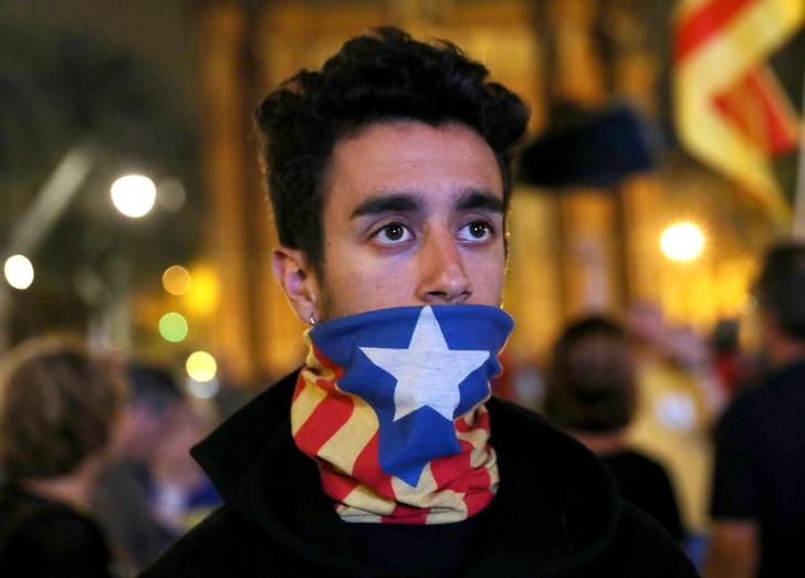 Catalonia stops short of formal independence to allow talks