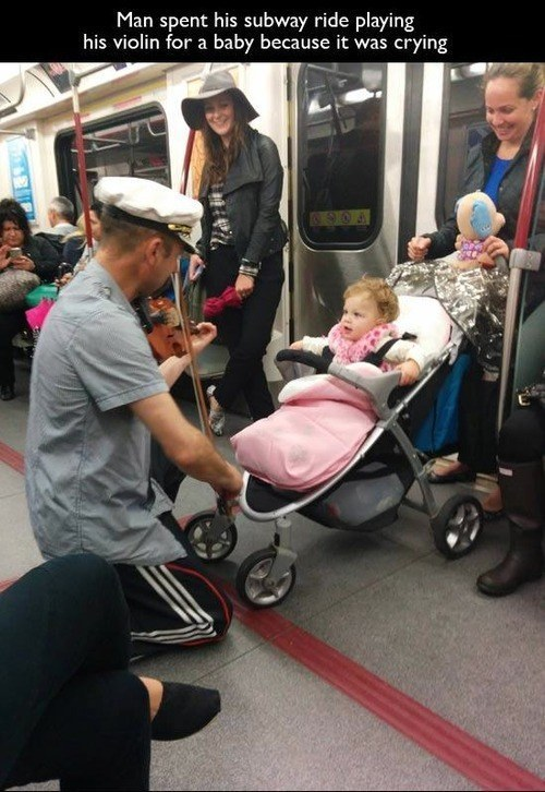randome-acts-of-kindness-man-comforting-a-baby-on-a-train
