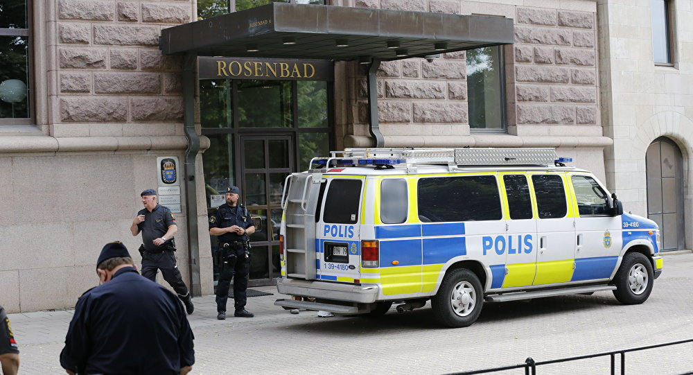 Police officers react in front of the main entrance at Rosenbad, the Swedish seat of the Government, in Stockholm