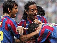 Van Bronckhorst (left) and Ronaldinho help Belletti celebrate his goal