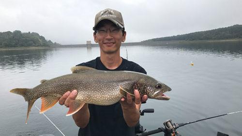 Zach Merchant holding a Lake Trout