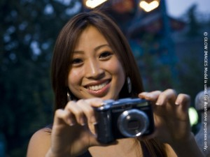 Woman taking a photograph smiling format