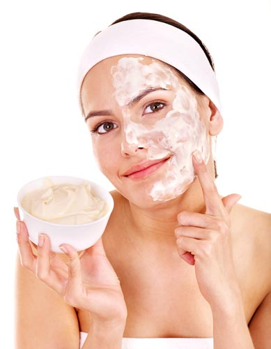 young lady wearing white headband applying cream on her face, DIY Homemade Face Mask for Glowing Skin