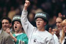 "Feb. 18, 1993: Two fans wear ""Puckhead"" hats during the national anthem at a Sharks game at the Cow Palace in Daly City."