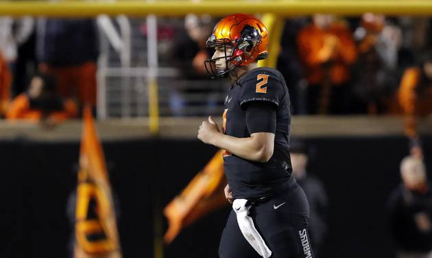 Oklahoma State\'s Mason Rudolph walks off the field after a fourth-quarter incomplete pass...