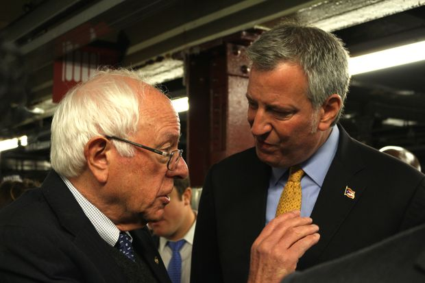 Sen. Bernie Sanders and Mayor Bill de Blasio chat while they wait for the A train.