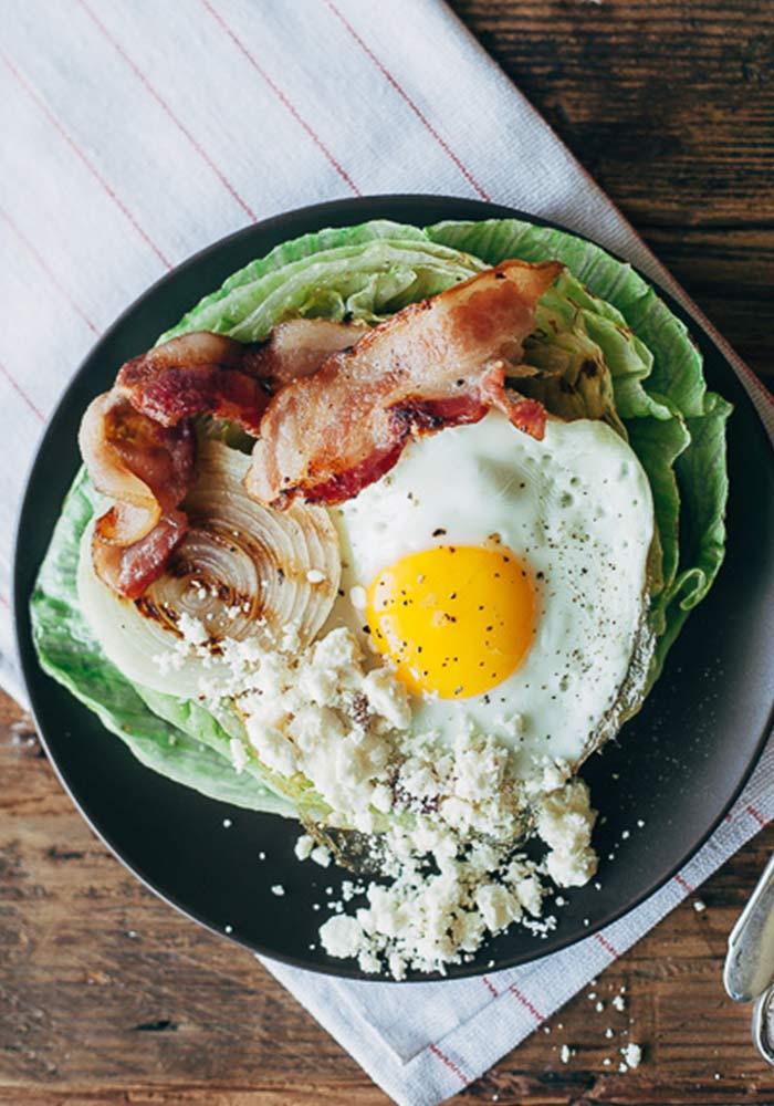 Grilled Wedge Salad with Fried egg and Cranberry Feta