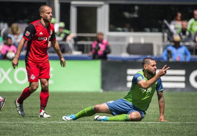 Clint Dempsey tells the referee that he's missed a couple of foul calls against him Saturday versus Toronto.  Toronto FC played the Seattle Sounders in a rematch of last year's MLS Cup Championship Saturday, May 6, 2017 at CenturyLink Field in Seattle.  (Dean Rutz / The Seattle Times)
