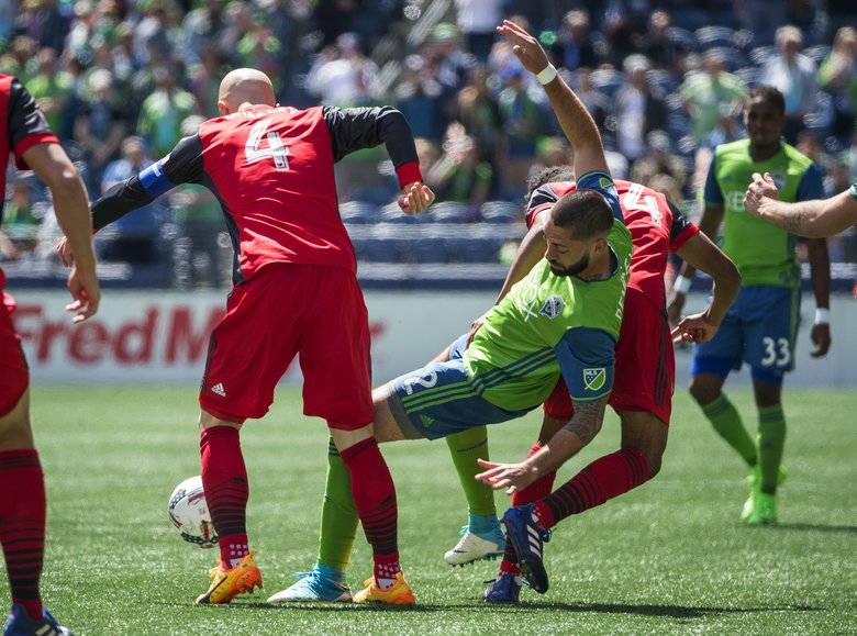 Clint Dempsey is fouled in the first half against Toronto.  Toronto FC played the Seattle Sounders in a rematch of last year's MLS Cup Championship Saturday, May 6, 2017 at CenturyLink Field in Seattle.  (Dean Rutz / The Seattle Times)