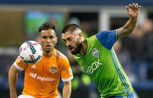 Houston Dynamo midfielder Eric Alexander (6) tries to pull down Seattle Sounders midfielder Clint Dempsey (2) before getting a yellow card during the Western Conference Championship second leg, at CenturyLink Field on Thursday, Nov. 30, 2017. At halftime Seattle Sounders leads 1-0.  204299