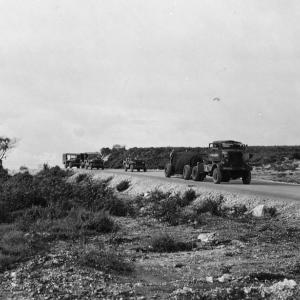 The Fat Man bomb being towed toward the airfield with an escort