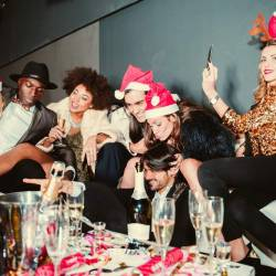 A group of people celebrating with champagne