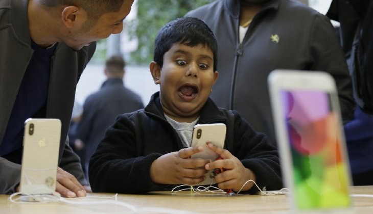 Teens' over-reliance on electronic devices for leisure can have devastating effects on their social and psychological health. (AP Photo/Eric Risberg)
