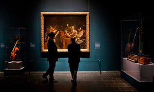 Visitors previewing an exhibit of French painter Valentin de Boulogne at the Metropolitan Museum of Art in New York.