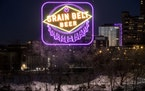 The Grain Belt sign was one of multiple locations that lit up as purpl...