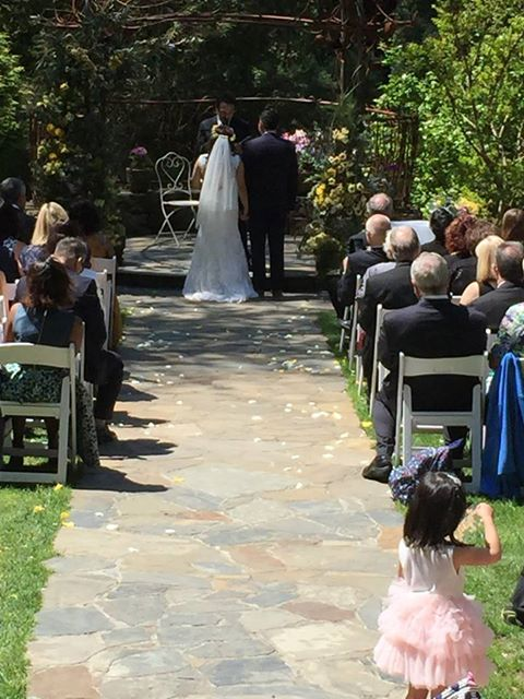 Image may contain: one or more people, wedding and outdoor