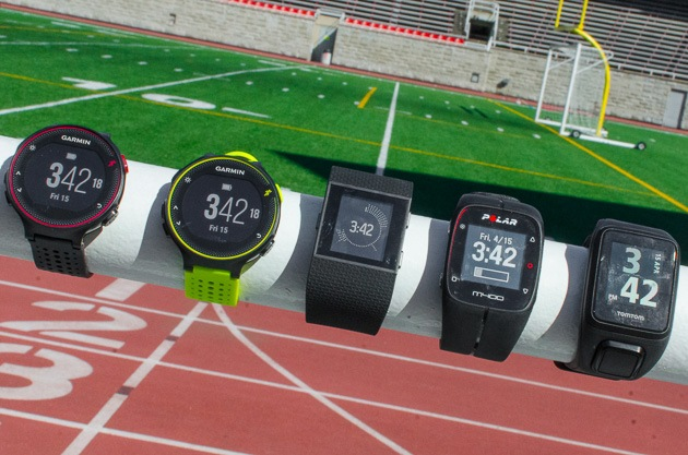Five different GPS running watches in various styles and colors.
