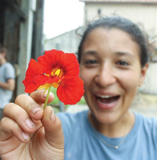 student holding a flower