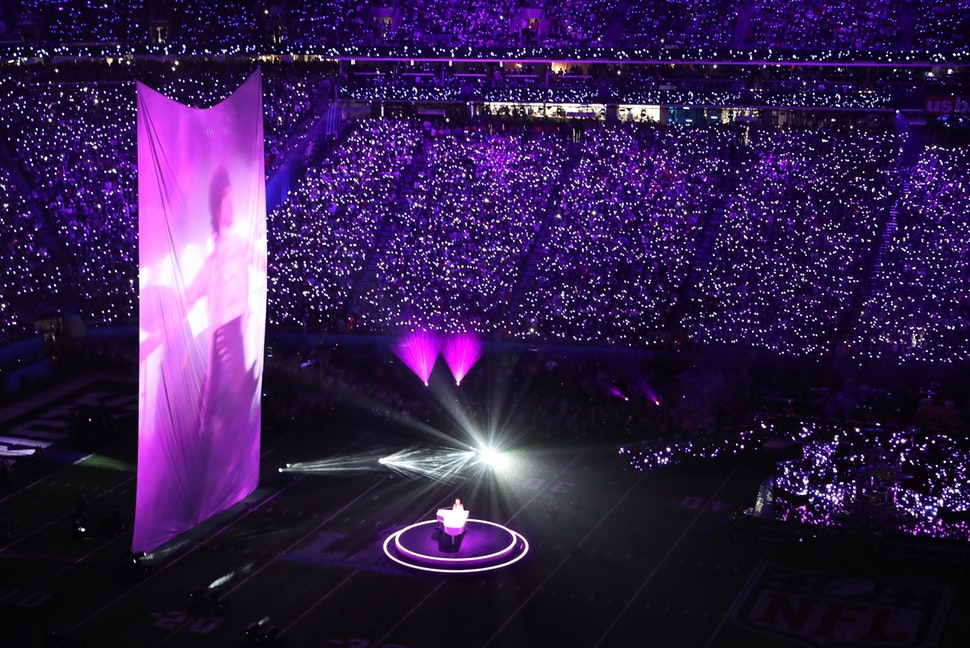 """Justin Timberlake pays tribute to Prince, singing """"I Would Die 4 U,"""" as video of the music icon performing in """"Purple Rain"""" is projected on a large screen during the Super Bowl halftime show."""