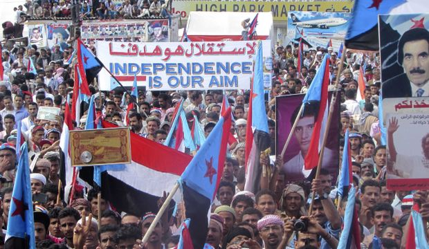 People waving South Yemeni flags demanding independence.