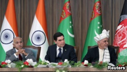 Afghanistan President Ashraf Ghani, right, Turkmenistan President Kurbanguly Berdymukhamedov, center, and India's Minister of State for External Affairs M.J. Akbar attend the inauguration ceremony of TAPI pipeline construction work, in Herat, Afghanistan.