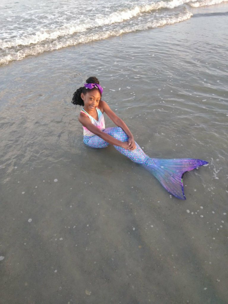 suntail mermaid fin on cocoa beach with surf and sand