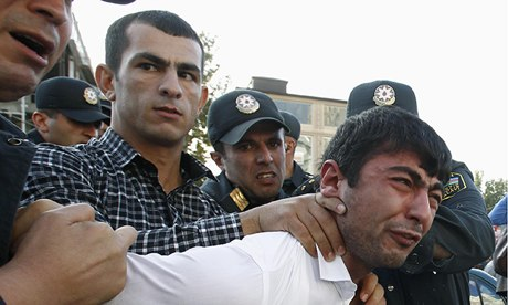 Police detain an opposition supporter in Baku, Azerbaijan