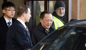 North Korean Foreign Minister Ri Yong Ho, second right, leaves the Swedish government building Rosenbad in central Stockholm, Sweden, Friday, March 16, 2018. (Vilhelm Stokstad /TT via AP)