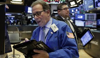 Trader Sal Suarino, left. works on the floor of the New York Stock Exchange, Friday, March 16, 2018. Global stock markets were mixed Friday amid caution about U.S. plans to raise tariffs on imports of steel and aluminum and uncertainty over White House politics. (AP Photo/Richard Drew)