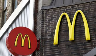 In this April 24, 2017, file photo, corporate signage hangs at a McDonald's restaurant in downtown Pittsburgh. (AP Photo/Keith Srakocic, File)