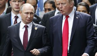 In this Nov. 11, 2017 photo, U.S. President Donald Trump and Russia's President Vladimir Putin talk during the family photo session at the APEC Summit in Danang, Vietnam. Trump repeatedly declared in his presidential campaign that he would improve relations with Russia but was never specific. A year into his presidency, its no more clear. Moscow and Washington are at odds over issues ranging from North Korea to Ukraine, despite Trumps open admiration of Putin.  (Jorge Silva/Pool Photo via AP, File)