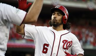 Washington Nationals' Anthony Rendon (6) celebrates his solo home run during the first inning of Game 2 of baseball's National League Division Series against the Chicago Cubs, at Nationals Park, Saturday, Oct. 7, 2017, in Washington. (AP Photo/Alex Brandon)