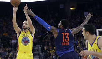 Golden State Warriors' Stephen Curry, left, shoots next to Oklahoma City Thunder's Paul George (13) during the second half of an NBA basketball game Saturday, Feb. 24, 2018, in Oakland, Calif. (AP Photo/Marcio Jose Sanchez)
