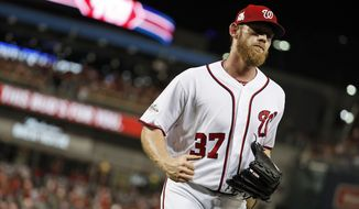 Washington Nationals starting pitcher Stephen Strasburg (37) jogs to the dugout during Game 1 of baseball's National League Division Series against the Chicago Cubs, at Nationals Park, Friday, Oct. 6, 2017, in Washington. (AP Photo/Alex Brandon)