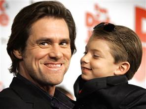 """Jim Carrey and Aaron Michael Drozin gesture at the premiere of """"Fun with Dick and Jane"""" in Los Angeles"""