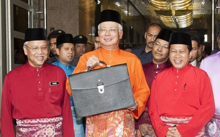 Malaysian PM Najib Razak with his budget briefcase. Photo: AFP
