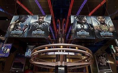 "Posters for ""Black Panther"" fill Edwards Houston Marq'e Stadium 23 & IMAX at a screening of the blockbuster film for the Boys & Girls Club of Greater Houston last week. (Photo by Bob Levey/Getty Images for IMAX)"