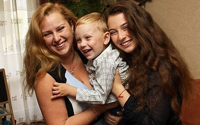 Anna Grigolaya, left, with her son and daughter. (Photo courtesy of Anna Grigolaya)