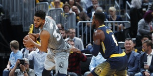 Timberwolves center Karl-Anthony Towns, left, is defended by Denver Nuggets forward Paul Millsap during the second half last week.