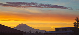 Photo of campus with mountain during sunrise