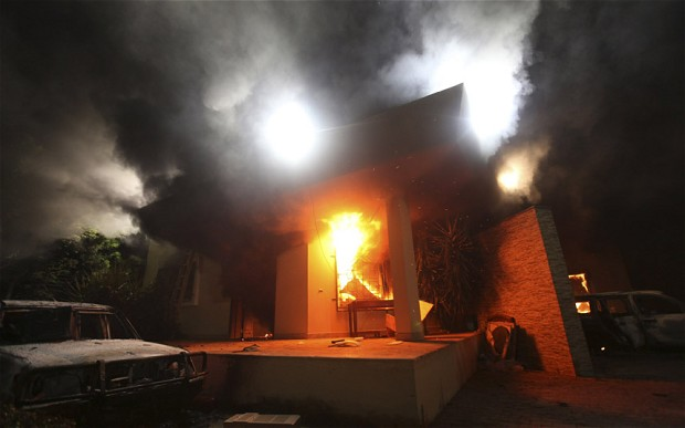 CIA running arms smuggling team in Benghazi when consulate attack: The U.S. Consulate in Benghazi is seen in flames during a protest by an armed group in this file photo taken September 11, 2012.