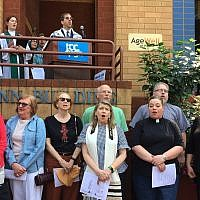 "Area clergy gather in front of the JCC, singing ""We Shall Overcome"" in a demonstration organized by the JCC's  Center for Loving Kindness and Civil Engagement, and Christian Associates of Southwest Pennsylvania. (Photo by Toby Tabachnick)"