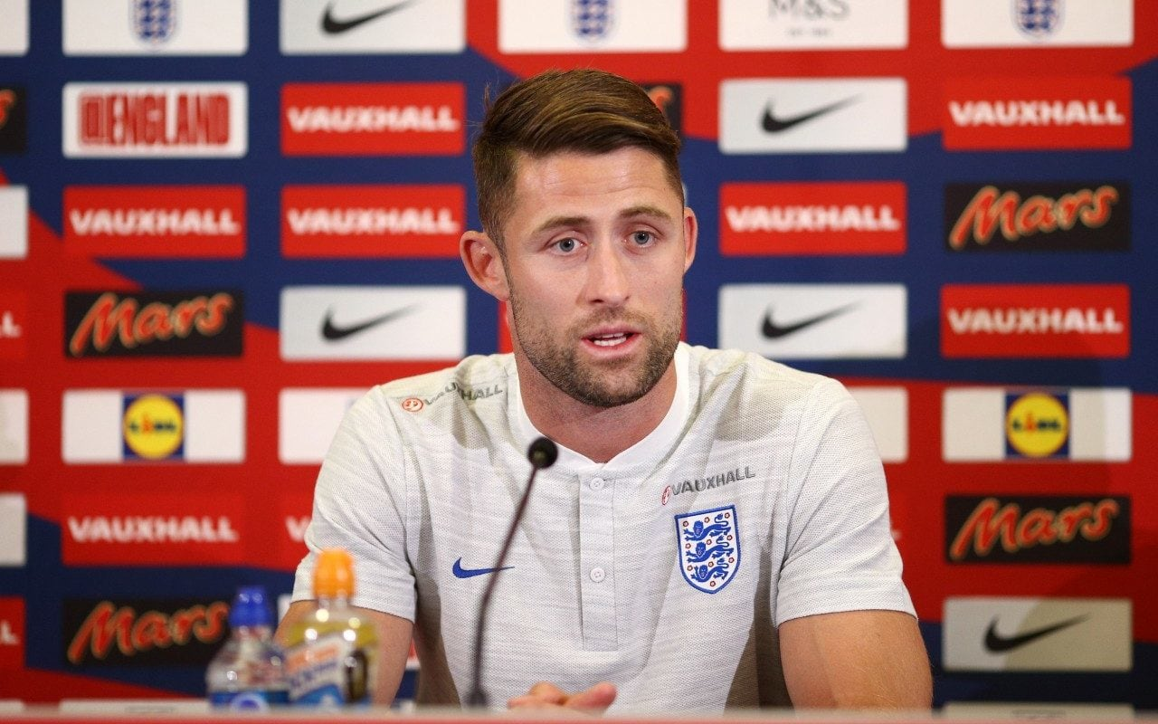 Gary Cahill of England speaks to the media during a press conference